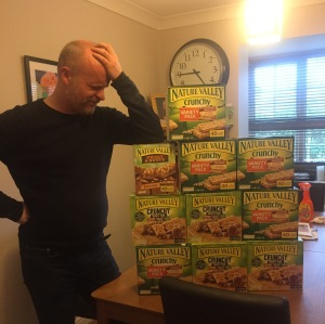 Andy with mountain of granola bars